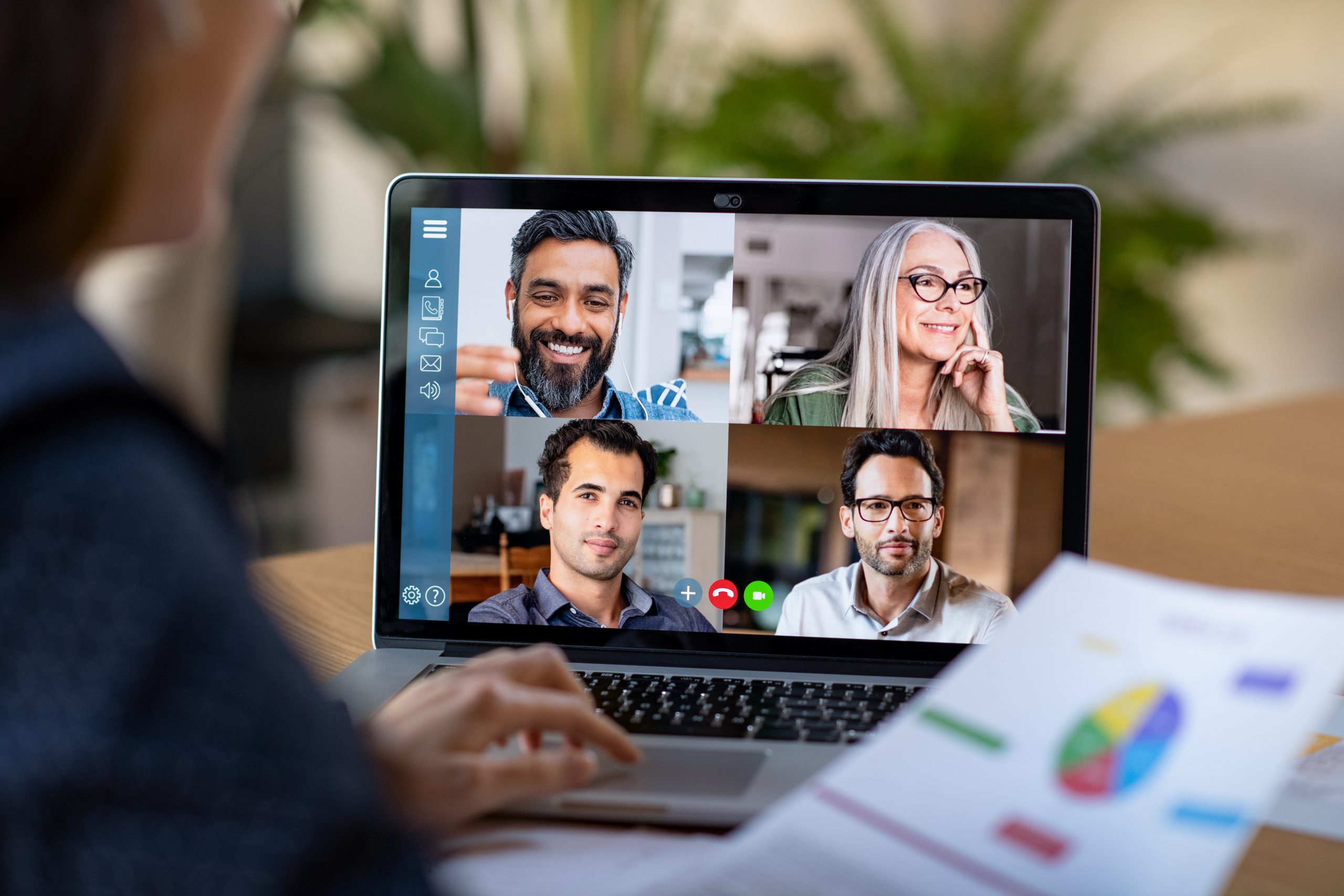 Woman working from home through video conference